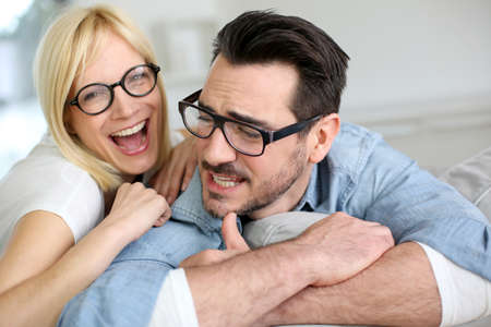 eyeglasses: Middle-aged couple wearing eyeglasses Stock Photo