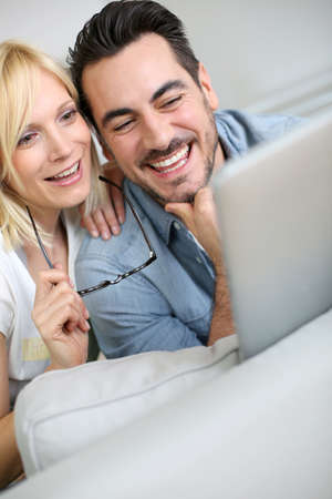 Cheerful couple websurfing on internet with tablet Stock Photo - 19753964