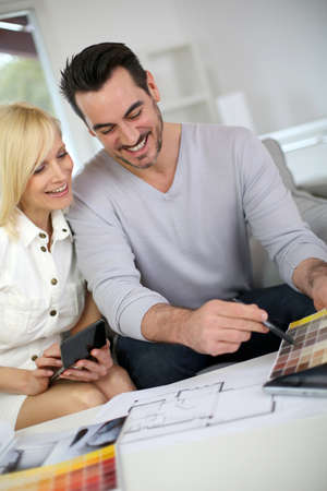 Couple working on home remodellng Stock Photo - 19685298
