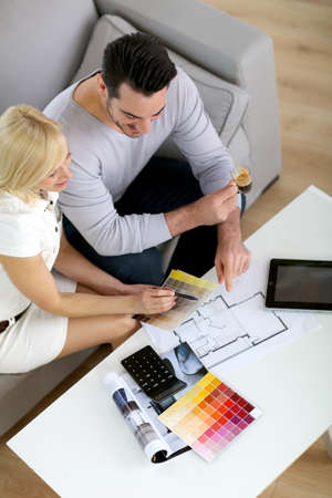 Couple working on home remodellng Stock Photo - 19685259