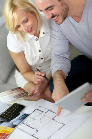 Couple working on home remodellng Stock Photo - 19685244