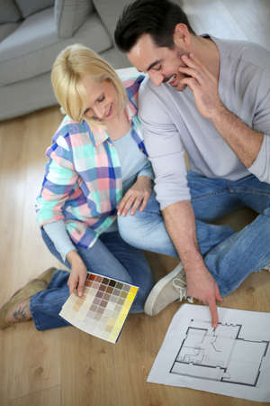 Couple looking at new home construction plan photo