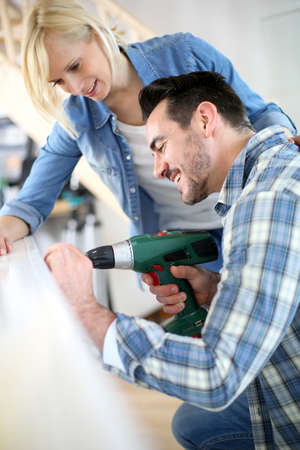 reforming: Couple installing furniture in new house Stock Photo