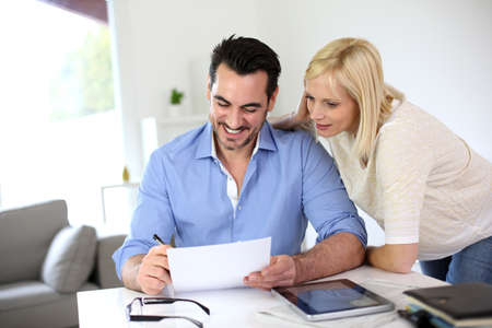 Middle-aged couple working from home Stock Photo - 19685288