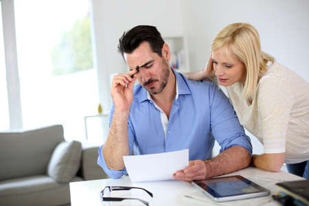 Middle-aged couple working from home Stock Photo - 19685284