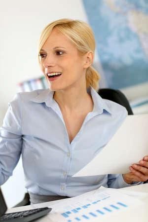 working woman: Businesswoman working on desktop computer Stock Photo