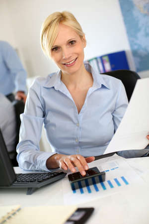 Businesswoman reading document at work Stock Photo - 19687534
