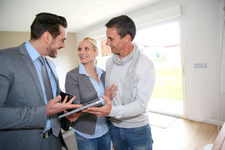 property agent: Middle-aged couple visiting house with salesman