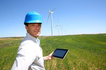 power in nature turbine: Businessman checking on wind turbine energy production Stock Photo