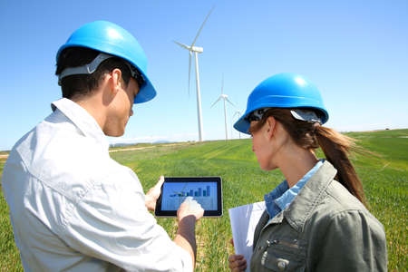 wind mills: Engineers using tablet on wind turbine site
