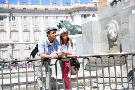 Couple standing in front of Madrid Royal Palace photo