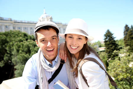 real madrid: Portrait of cheerful couple in front of Palacio Real de Madrid