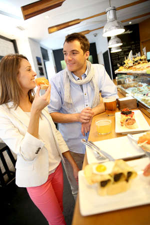 tapas: Couple in Madrid eating Spanish savouries