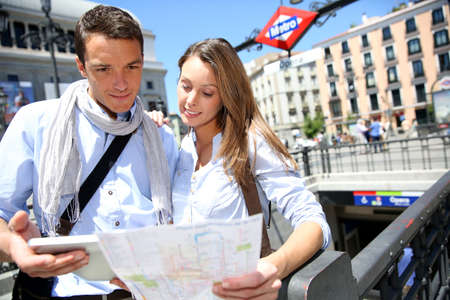 subway entrance: Couple of tourists in Madrid at subway entrance Stock Photo