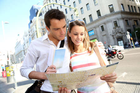 Couple of tourists in Gran Via avenue of Madrid photo