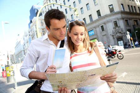 gran via: Couple of tourists in Gran Via avenue of Madrid