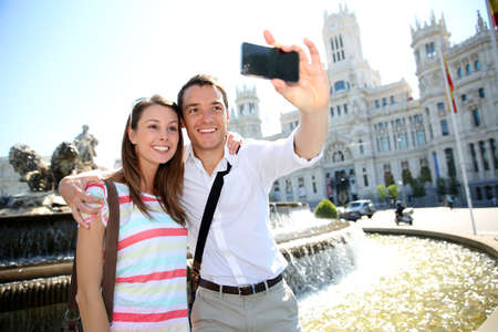 madrid  spain: Couple taking pictures in Plaza de Cibeles, Madrid