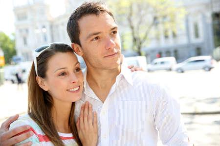 Sweet couple walking in city avenue photo