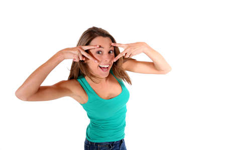 uncovering: Cheerful girl with hands uncovering her eyes
