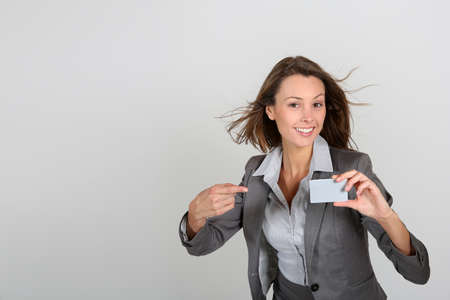 Businesswoman showing businesscard, white background photo