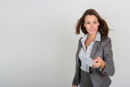 gray suit: Businesswoman showing businesscard, white background