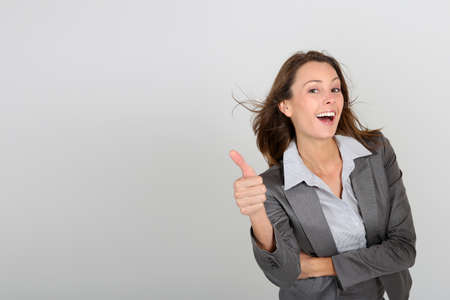 textspace: Successful businesswoman showing thumbs up Stock Photo