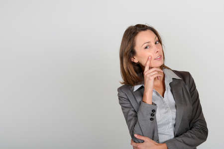 paying attention: Businesswoman with doubtful look Stock Photo