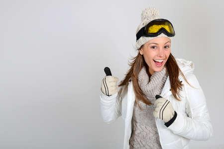 ski mask: Skier woman showing thumbs up