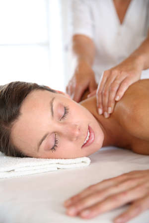 wellness center: Beautiful girl receiving oil massage in beauty salon