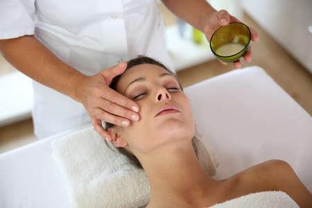facial: Woman receiving a face massage
