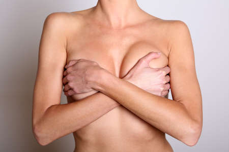 woman chest: Closeup of a woman with hands over chest