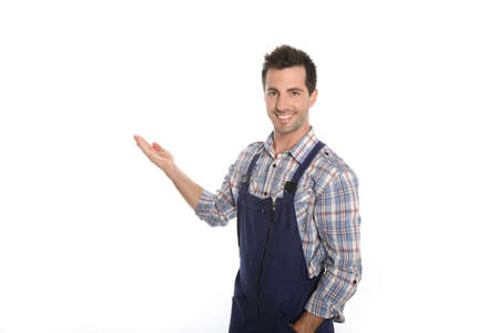 craftsmen: Cheerful craftsman pointing at message on whiteboard Stock Photo