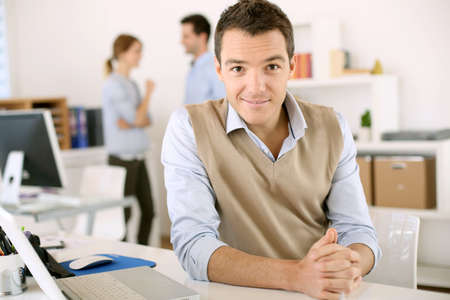 Portrait of smiling man sitting in office photo