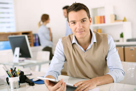 entrepreneur: Handsome guy working with tablet in office