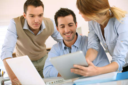 casual people: Business project presentation on digital tablet