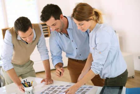 creative communication: Creative team selecting image shots Stock Photo