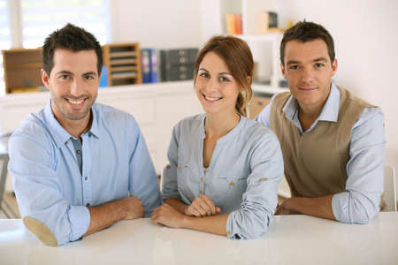 Business team sitting at desk in office Stock Photo - 20200043