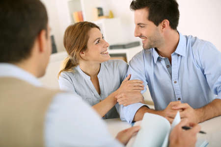 financial advice: Young couple meeting construction planner Stock Photo