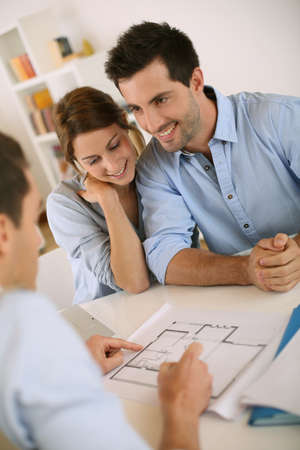 business consultant: Young couple meeting architect for future house