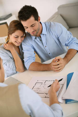 blueprint: Young couple meeting architect for future house