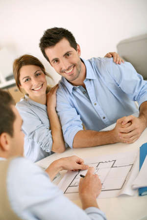 building planners: Young couple meeting construction planner Stock Photo