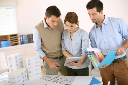 Team of architects working in office photo