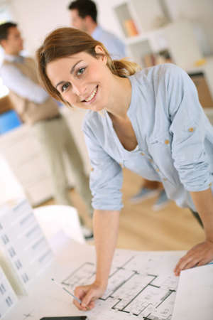 Young woman architect working in office photo