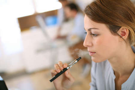 substitution: Portrait of woman smoking with electronic cigarette