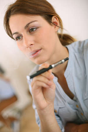 Portrait of woman smoking with electronic cigarette Stock Photo - 20190442
