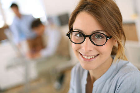 Cheerful student girl wearing eyeglasses photo
