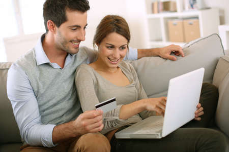 Couple using credit card to shop on internet photo