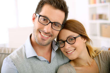 Cute young couple with eyeglasses on photo