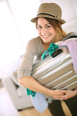 Cheerful girl leaving for vacation photo