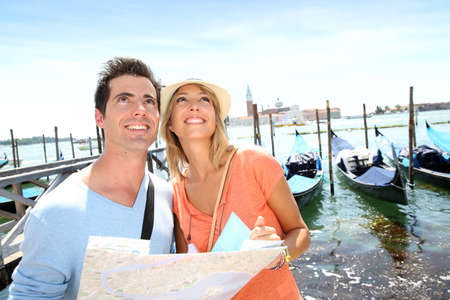venice italy: Tourists looking at map in front of San Giorgio Maggiore Island, Venice
